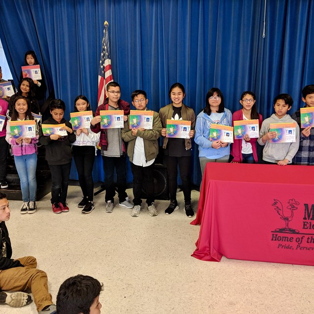 Our 6th grade students proudly show their honor roll awards. Congrats students!
