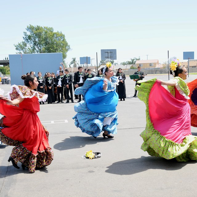 On our Cinco de Mayo celebration, students watch as performers dance in honor of the holiday.